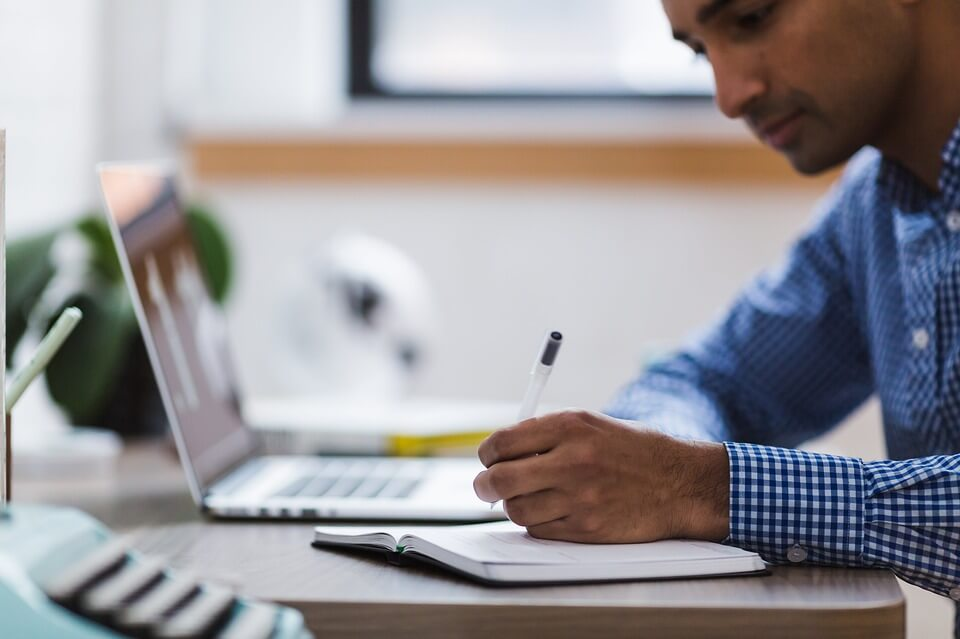 Better Research and Prospecting Image in Outsource Workers - Man Researching Using Computer Laptop and Notes