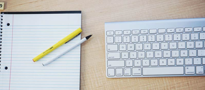 Content Writing and Copywriting Image in Outsource Workers - Keyboard and Notebook and Pens