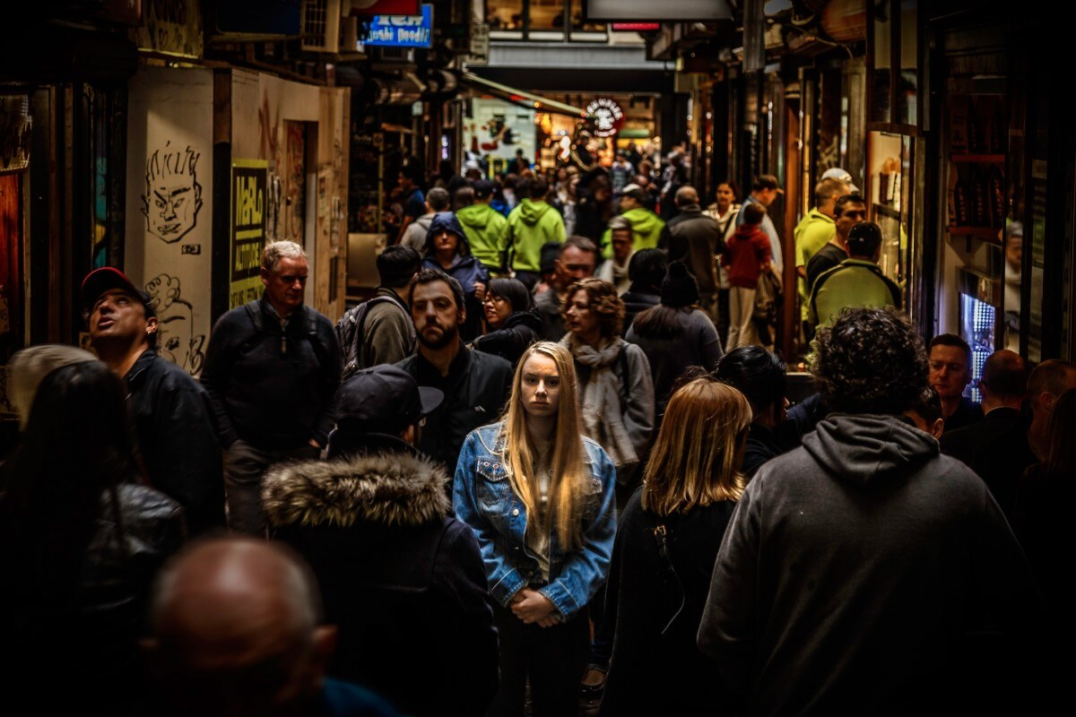 Data Capturing Image in Outsource Workers Woman Stand Out in a Crowd Dark