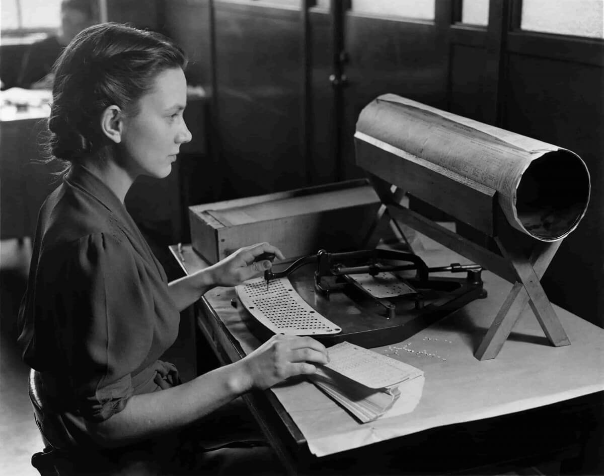 Data Entry Key Skills Image in Outsource Workers - Girl Doing a Entry Tasks on a Machine