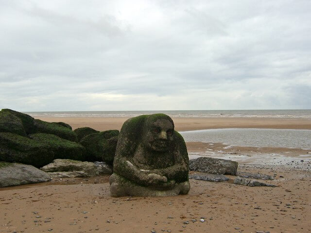 Effective Cold Calling Image in Outsource Workers - Win the Trust of Gatekeeper Ogre by the Beach Statue