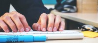 Email Content vs Online Content Image in Outsource Workers Man Typing on White Keyboard
