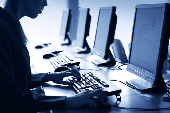 Outsourcing Content Writing Image in Outsource Workers - Agent Office Personnel Working on a Computer Blue