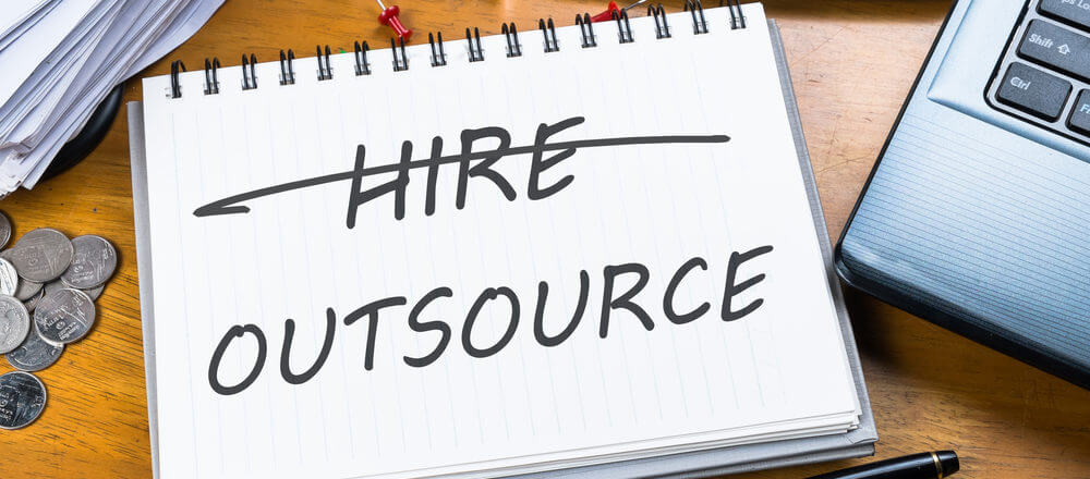 Outsourcing Real Estate Tasks Image in Outsource Workers - Hire Vs Outsource on Notepad