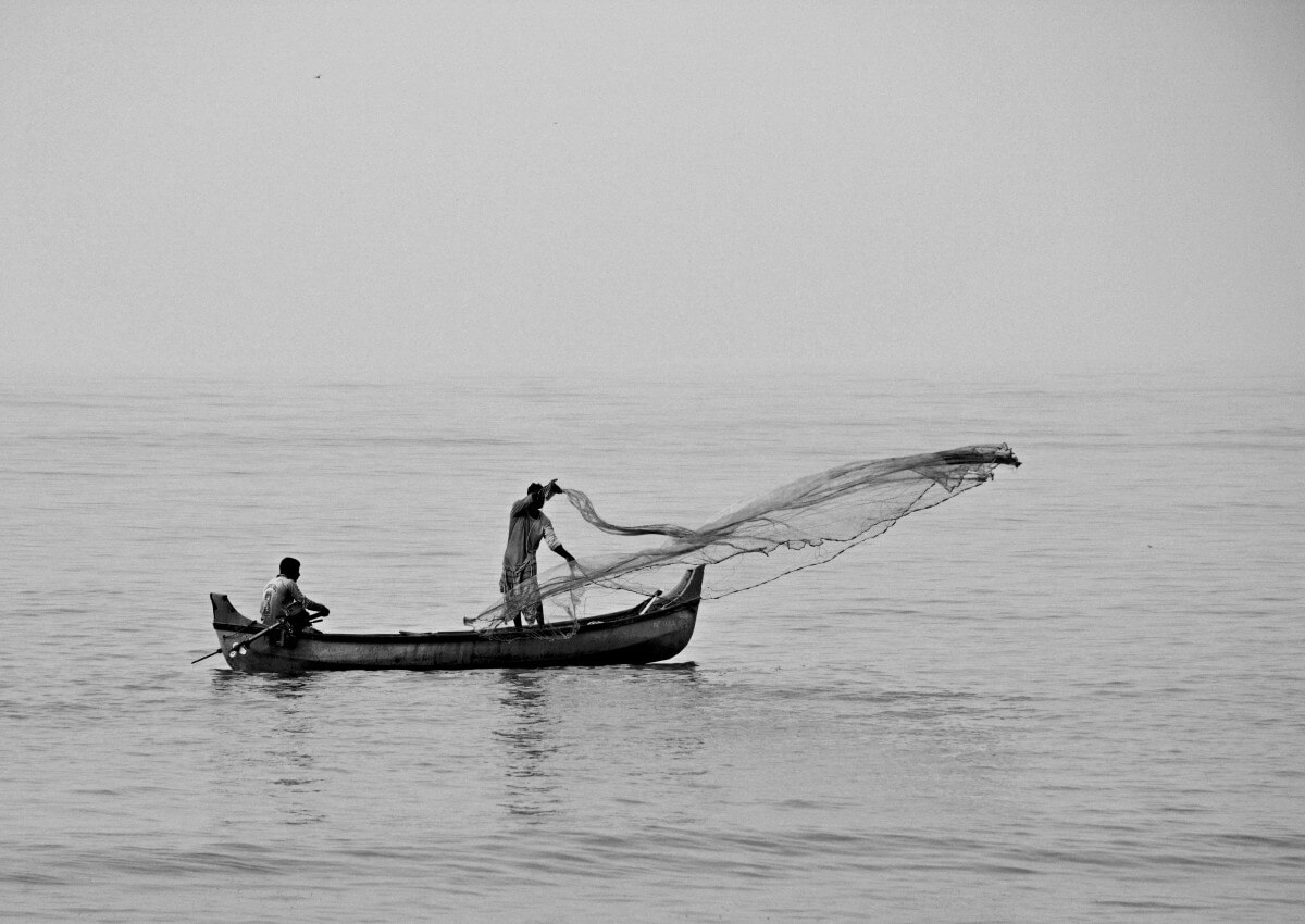 Prospect Prioritisation Image in Outsource Workers - Fisherman Casting Nets on Sea Black and White