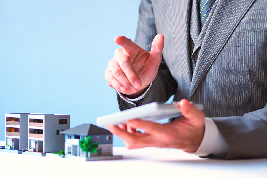 Real Estate Admin Tasks Outsourcing Image in Outsource Workers - Real Estate New Client Listings Miniature Estate Beside a Man
