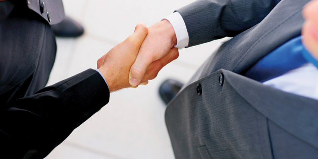 Skills and Qualities of Virtual Assistant Image in Outsource Workers - Professionals Men in Suit Shaking Hands